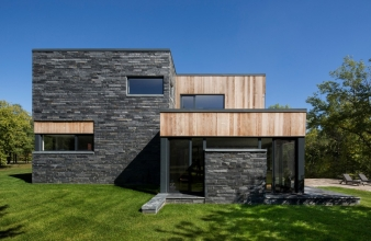A custom technical detail was developed to extend this cladding to exterior ground level