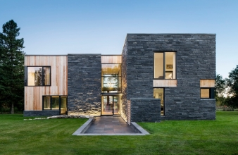 The exterior cladding of the house is composed of slate sourced from a nearby quarry