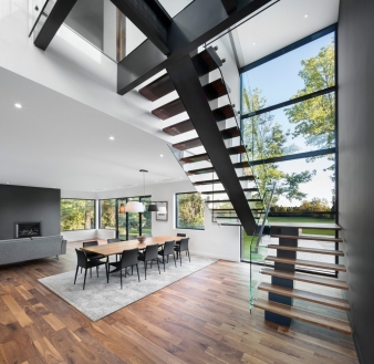 Sculptural stair in new home by SIMARD architecture