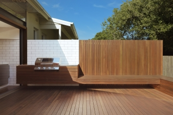 An extension of the kitchen bench leads to a BBQ area with spotted gum decking and built in seating connecting the living space to the garden and playing area