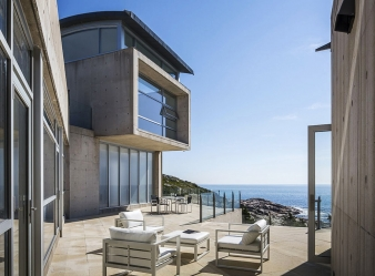 The house is set on landscaped terraces that provide a platform for lounging areas that open up to the views