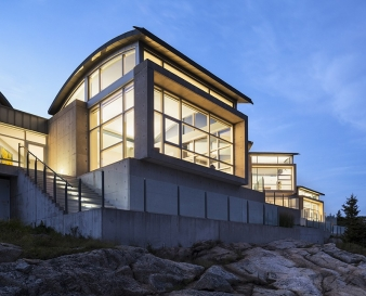 The concrete and glass pavilions that soar above the rocks; their curved roofs are both practical and dramatic