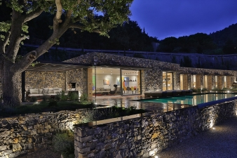 Dusk view of the villa and pool