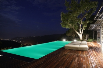 The infinity edge pool is lit up at night