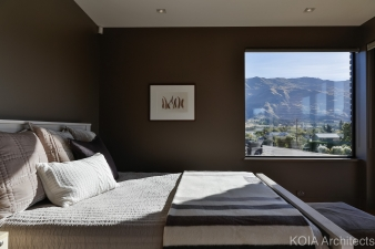 The home was designed around the position of the property. From the master bedroom, you can see the surrounding hills and lake