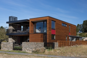 To achieve a strong street presence, the architect covered the majority of house in horizontal cedar battens