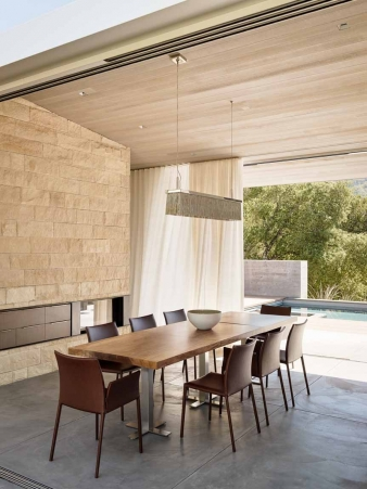 Dining room doors slide seamlessly into walls to create an outdoor dining pavilion