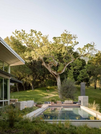 The great room in this new home by Feldman Architecture overlooks a 70 foot pool