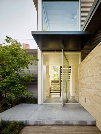 Pivot glass door in new home by Feldman Architecture