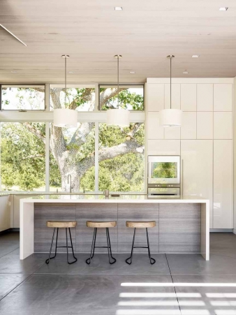 Windows in the kitchen of  this new home face directly into a courtyard