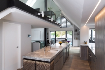 Glass balustrading ensures the full double-height volume can be appreciated from all the living areas