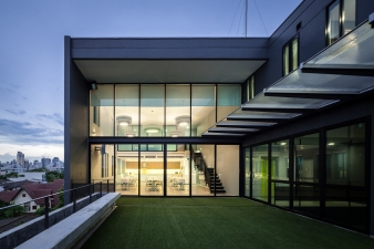 A cafeteria with a courtyard area sits atop the building