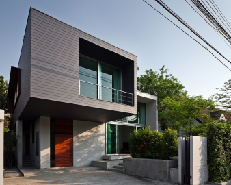The house is composed of two main sections with distinctive, contrasting textures and colors