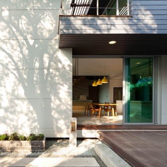 Large sliding glass doors provide easy access to the large courtyard area