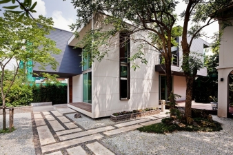 Green space surrounds the property, offering privacy
