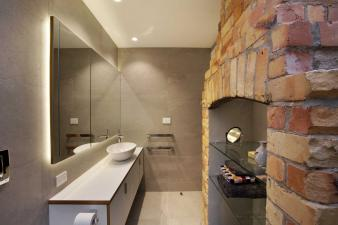 Doublesided fireplace in renovated villa. Image: 13